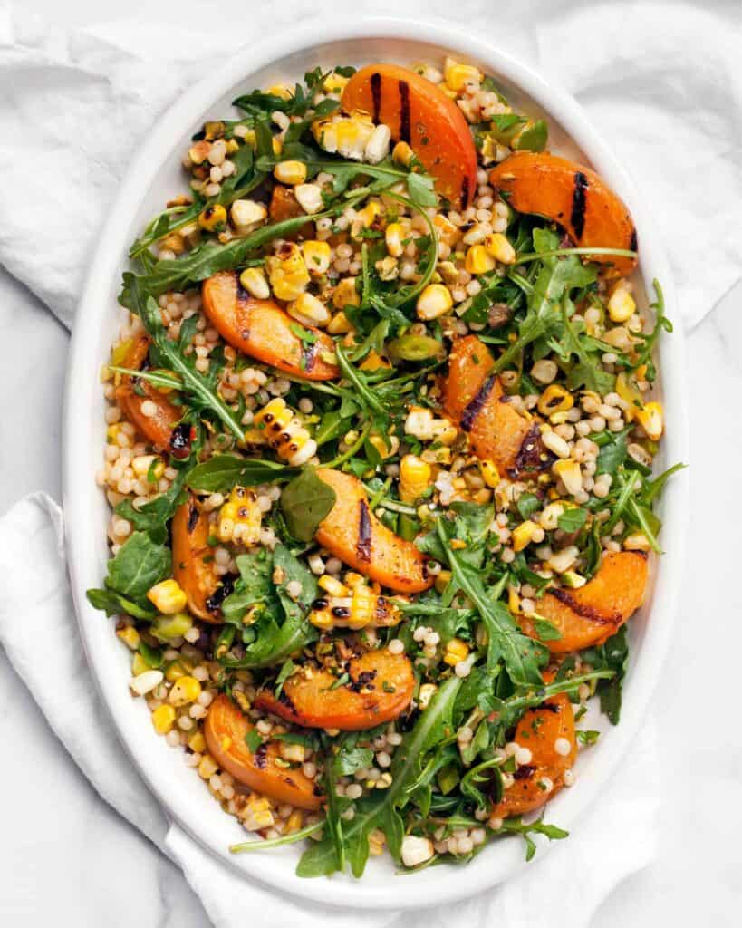 Grilled Apricot and Corn Harissa Couscous