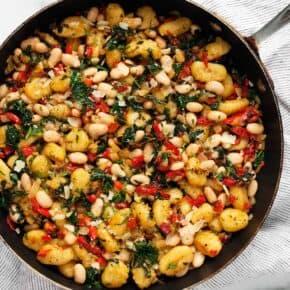 Red Pepper White Bean Gnocchi in a skillet