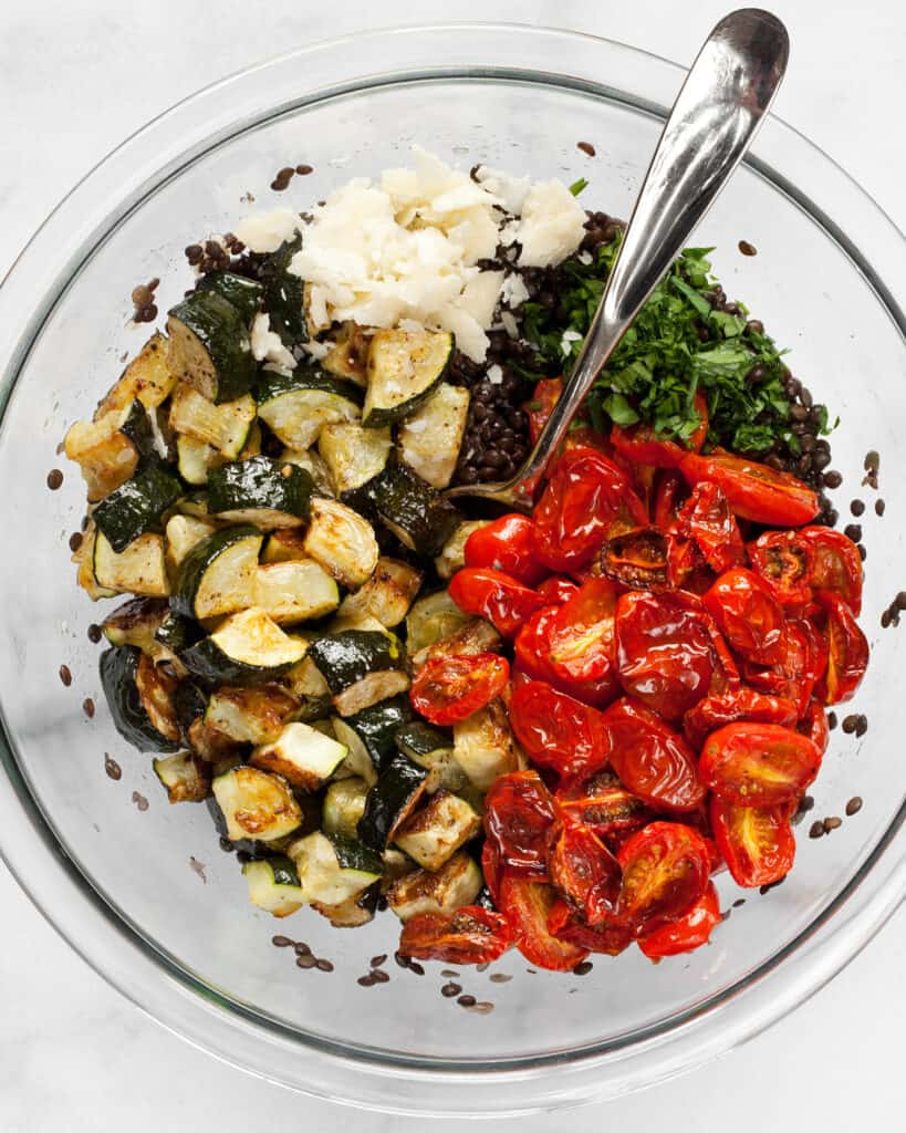 Tomatoes and zucchini in bowl with lentils