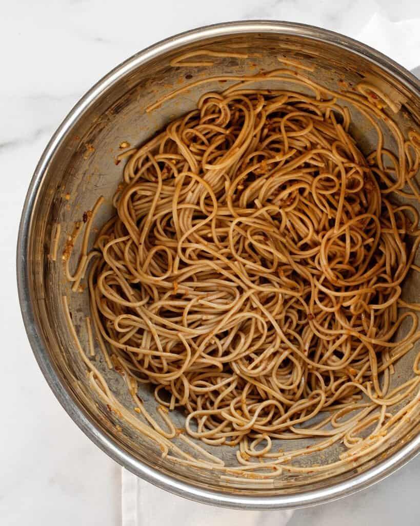 Stirring sauce into soba noodles