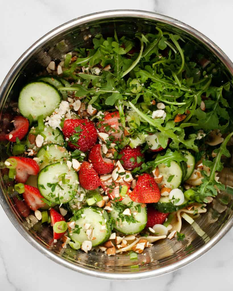 Mixing together the salad ingredients
