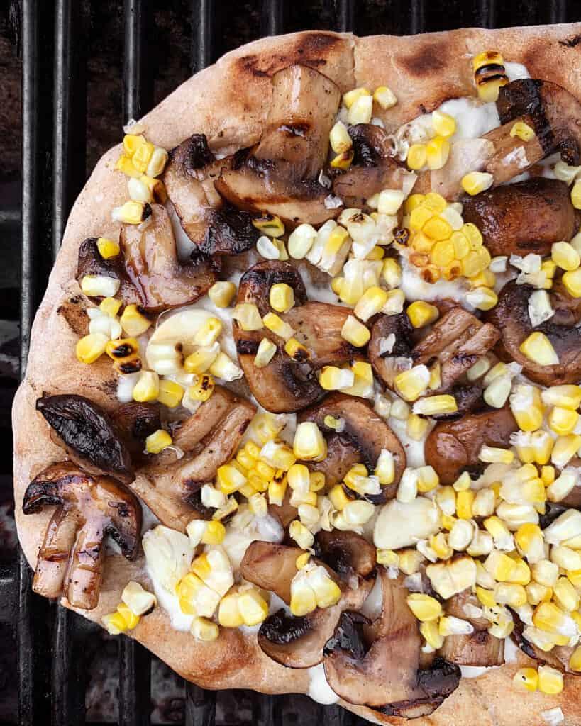 Mushroom corn pizza on the grill