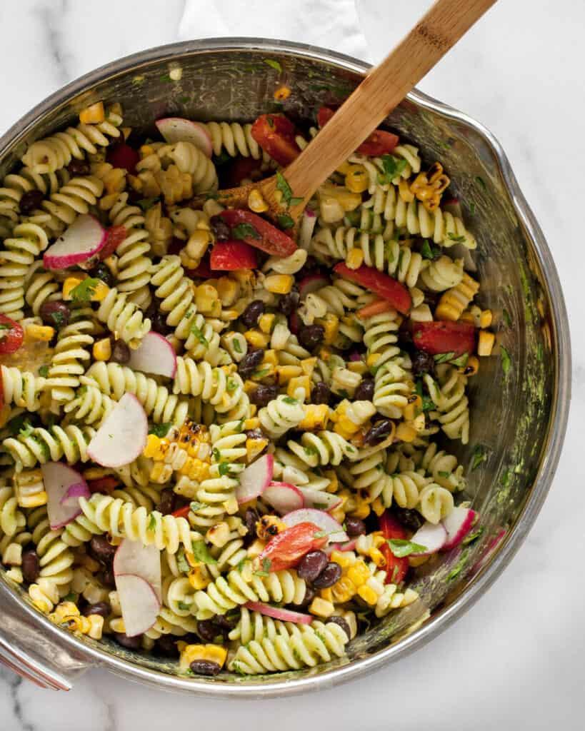 Stirring together pasta and vegetables