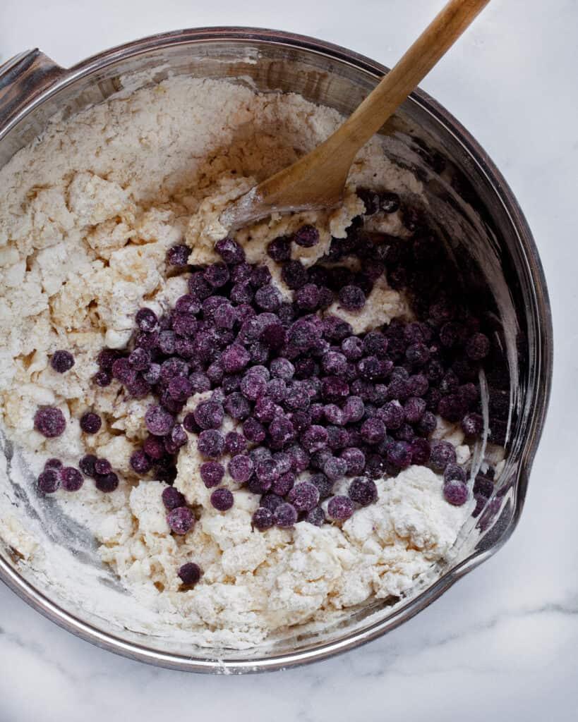 Stirring blueberries into scone dough