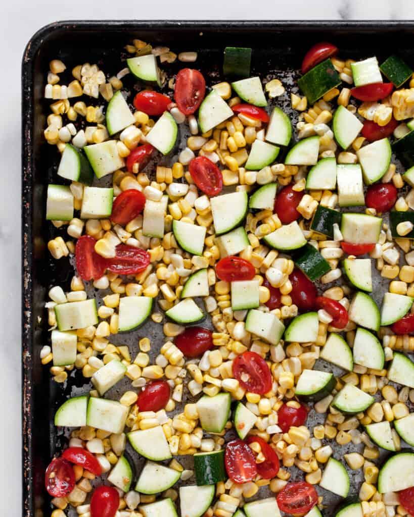 Zucchini, corn & tomatoes on a sheet pan