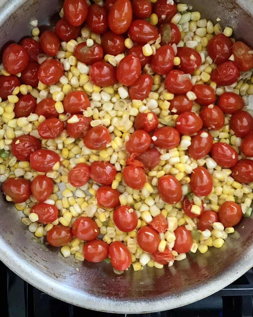 Cherry tomatoes and corn in a skillet