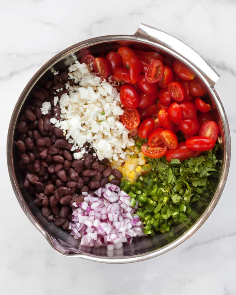 Corn black bean salad ingredients in a bowl