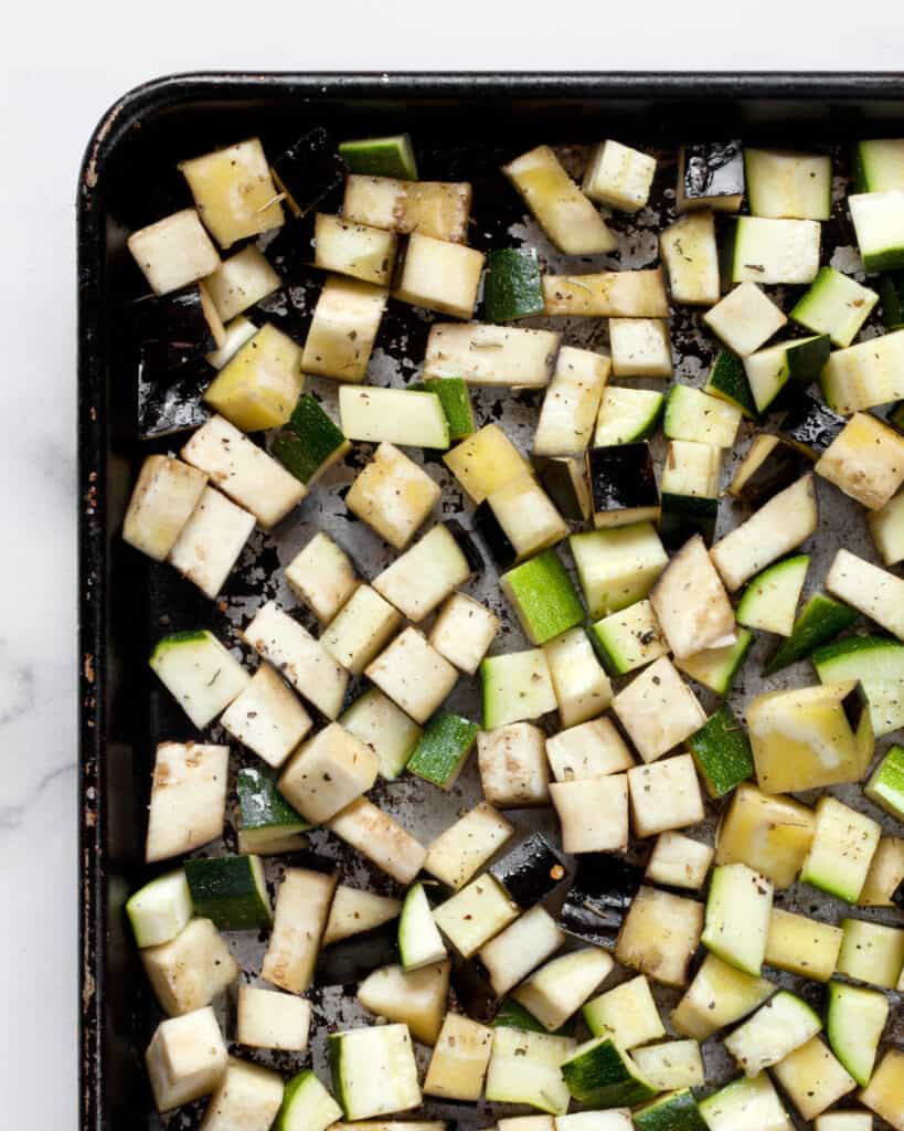 Diced zucchini and eggplant on a sheet pan