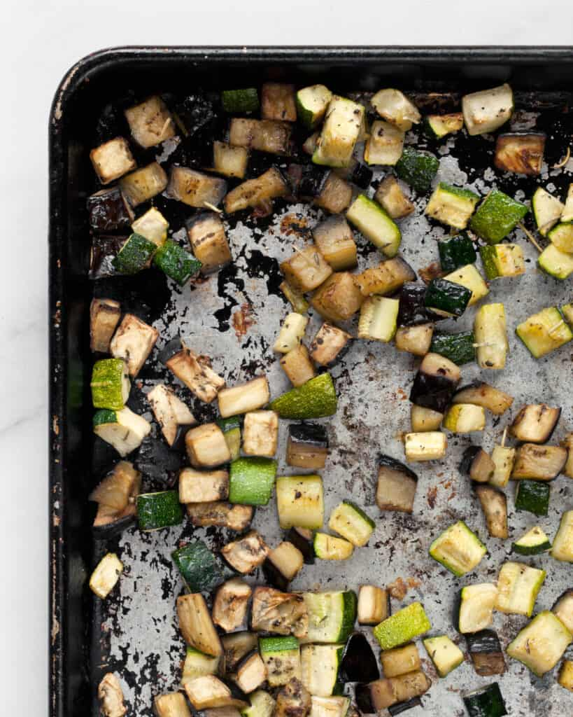 Roasted diced zucchini and eggplant on a sheet pan