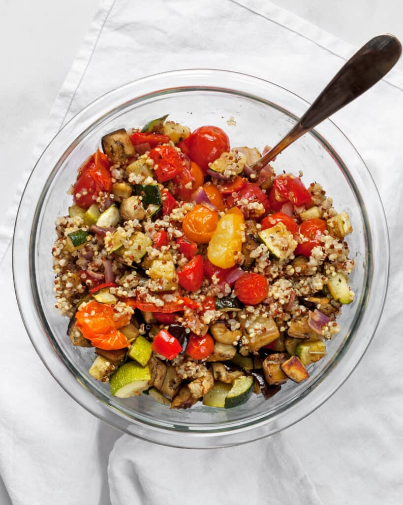 Stir together the vegetables and quinoa