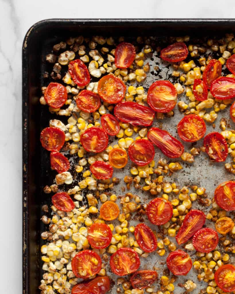 Roasted corn and tomatoes on a sheet pan