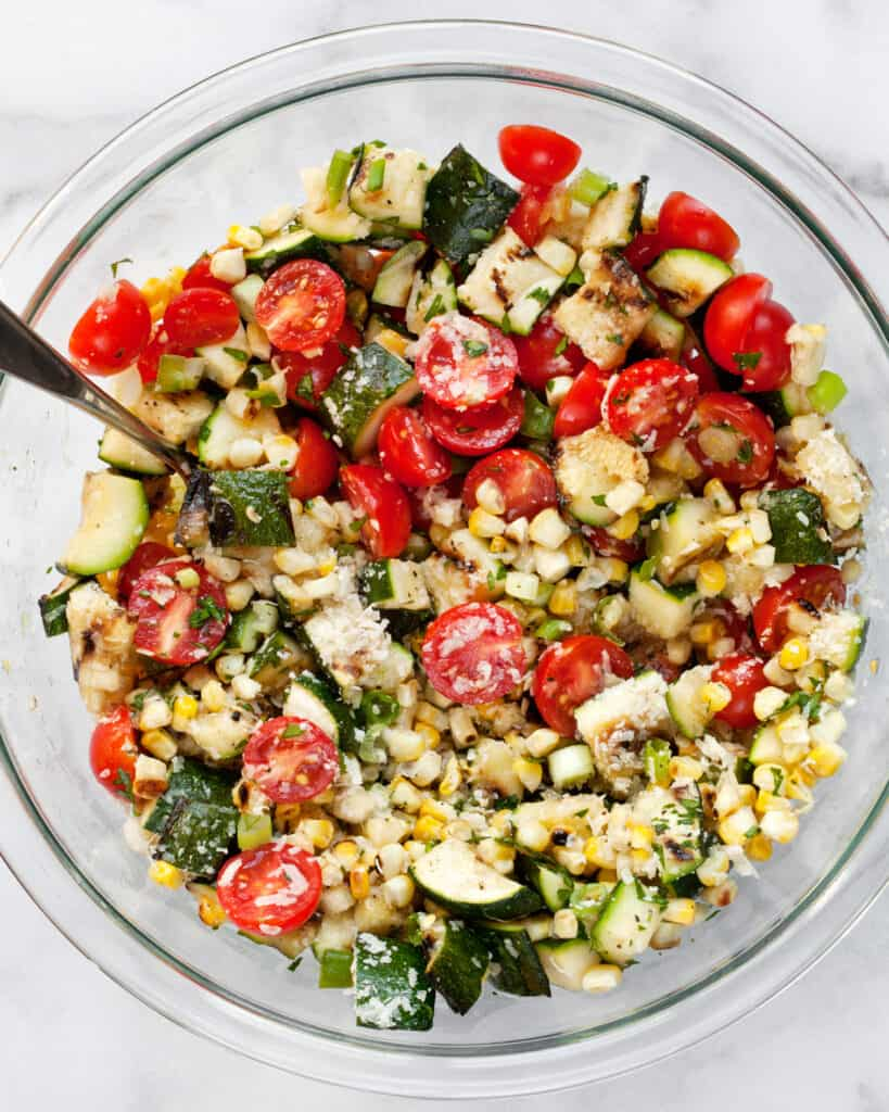 Stirring together the salad ingredients