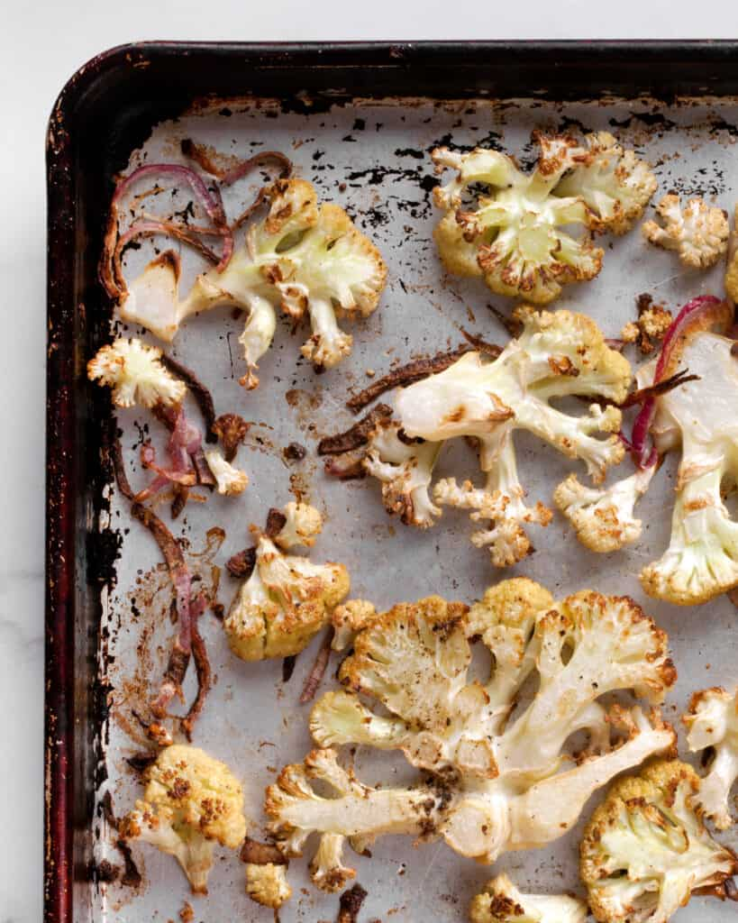 Roasted cauliflower and onions on a sheet pan