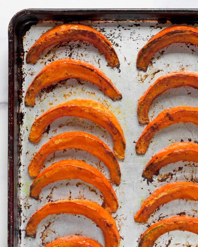 Roasted squash wedges on sheet pan