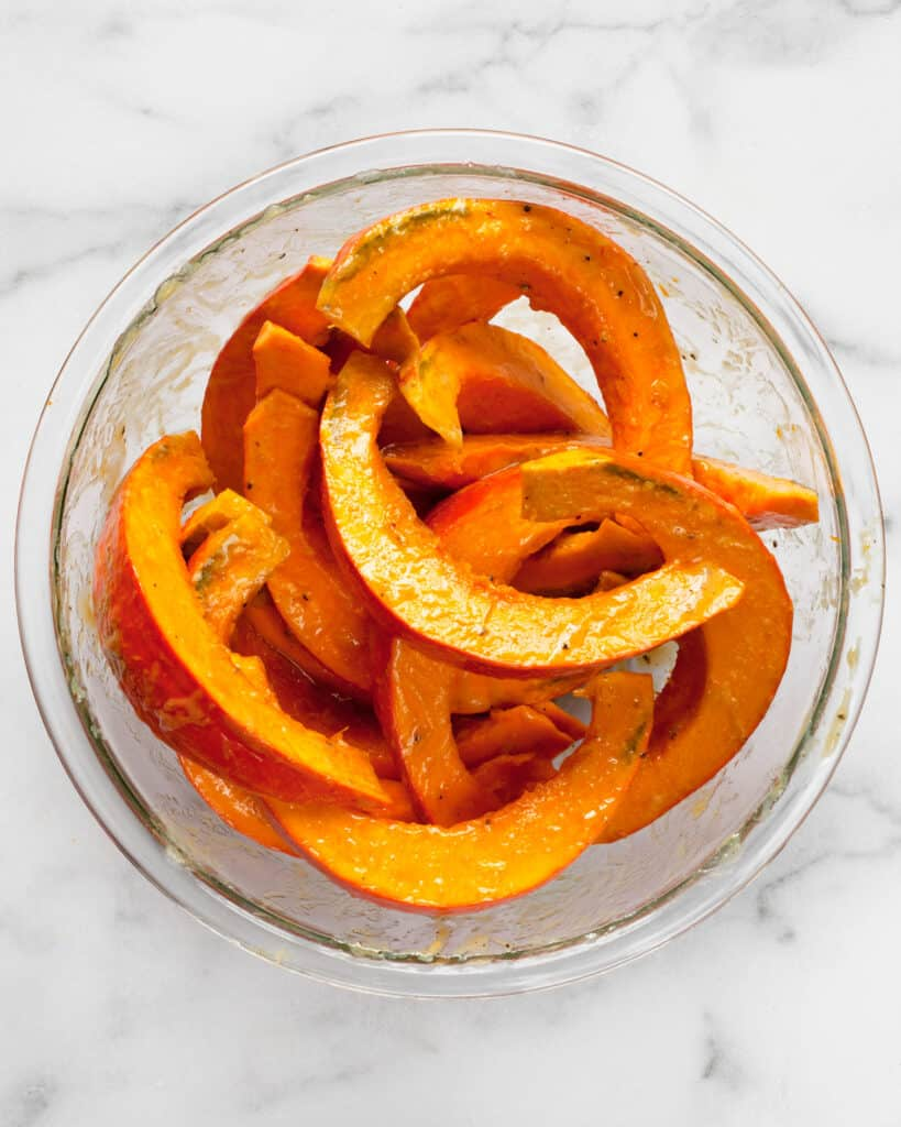 Toss squash wedges in bowl with miso marinade